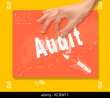 A hand picking up a Audit concept on a colorful drawing board. - Stock Image