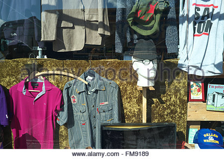 Window display of second hand clothes for sale in a shop in Archway, London, UK. - Stock Image