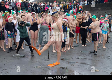 Tragumna, West Cork, Ireland, December 25th 2018. A mild Christmas morning greeted the annual crowds for the traditional swim on Tragumna beach. Credit: aphperspective/Alamy Live News - Stock Image