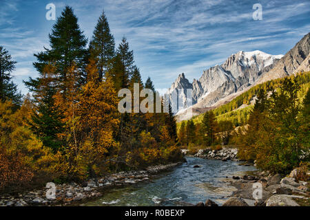 The river in Ferret Valley during the autumn season with the Mont Blanc wall in the background and clouds in the sky - Stock Image