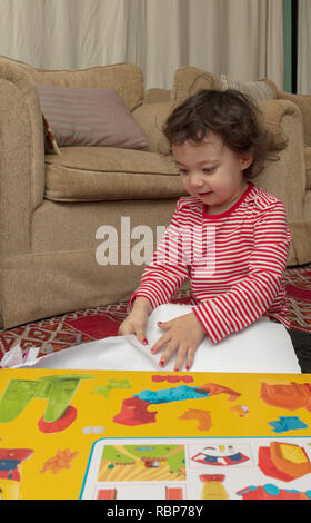 happy young girl opening present - Stock Image