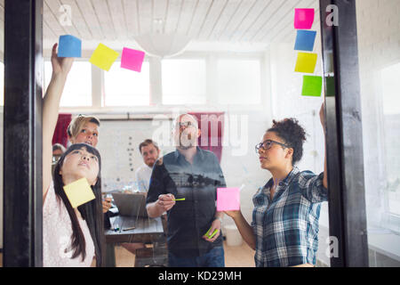 Group of coworkers brainstorming in office - Stock Image