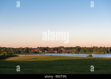 Viewing the village of Kirchbarkau on Lake Bothkamp from the western shore, Rendsburg, Eckernförde, Schleswig-Holstein, Germany, Europe - Stock Image