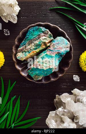 Chrysocolla with Smoky Quartz and Mums on Dark Wood - Stock Image