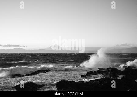 Waves break over the Miura Peninsula, Japan with Mount Fuji in the background - Stock Image