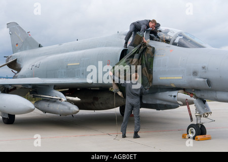 Covering jet intakes with protective canvas, Luftwaffe McDonnell F-4F Phantom II during airshow in Brno 2007 - Stock Image