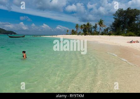 Beach fun on Koh Lipe pristine beach and sea, Thailand - Stock Image