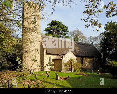 The village church in Horsey, Norfolk is one of many in the county with a round tower rarely found outside East Anglia. - Stock Image