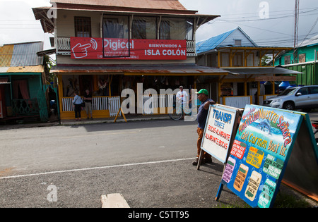 Signboards advertising boat trips and other excursions at Bocas del Toro Panama. - Stock Image