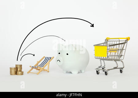A stack of coins with a deck chair, piggy bank and a shopping trolley with 3 arrows, symbolic for distributing income, - Stock Image