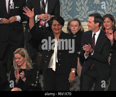 February 5, 2019 - Washington, District of Columbia, U.S. - Alice Johnson who had been serving a mandatory life sentence without parole for charges associated with a nonviolent drug case waves to the audience as she is introduced by United States President Donald J. Trump during his second annual State of the Union Address to a joint session of the US Congress in the US Capitol in Washington, DC on Tuesday, February 5, 2019. Johnson, who's case was brought to the President's attention by actress Kim Kardashian and Senior Advisor Jared Kushner, right, was granted clemency on June 6, 2018. Cre - Stock Image
