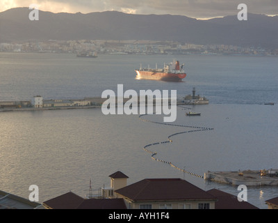 Dusk over the Bay of Gibraltar, boom, shipyard shipyards sunset sunsets dusk evening nightfall  Gibraltar Harbour , - Stock Image