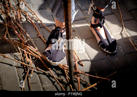 Traditional 19C footware of a grape dryer of grapes who makes raisins at a Spanish Fiesta - Stock Image