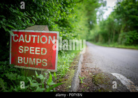 caution speed bumps sign along a narrow road in Lincolnshire England - Stock Image