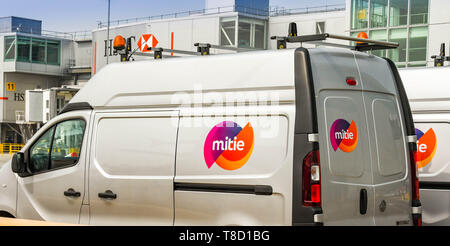 NICE, FRANCE - APRIL 2019: Vans owned by Mitie airside outside the Suth Terminal at London Gatwick Airport. Mitie is a facilities management and profe - Stock Image