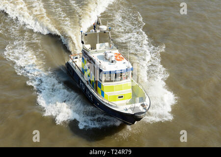 A Thames Division police launch speeding down the River Thames in London, UK - Stock Image