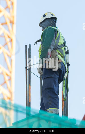 Engineer were walking up the stairs to survey the construction site. - Stock Image