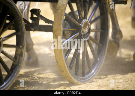 Wheels hooves horse drawn chariot Jerez Spain - Stock Image