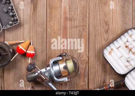 Fishing tackle on wooden background. Accesories for fishing with copyspace . - Stock Image