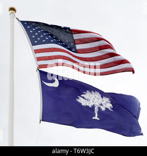 The flags of the United States of America and South Carolina flying on a flagpole. - Stock Image