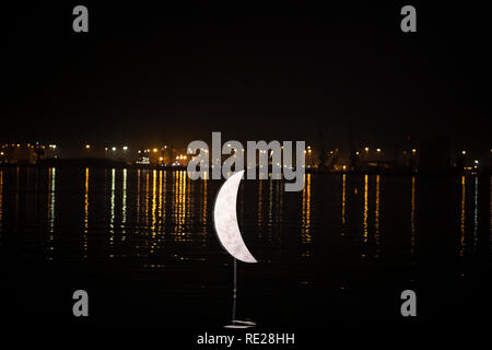 Lighting of the sculpture 'Moon' by Pavlos Vasiliadis artist, at the seafront of Thessaloniki, January 18, 2019. - Stock Image
