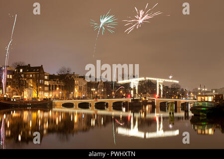Amsterdam with firework on New Year's Eve/turn of the year.. - Stock Image