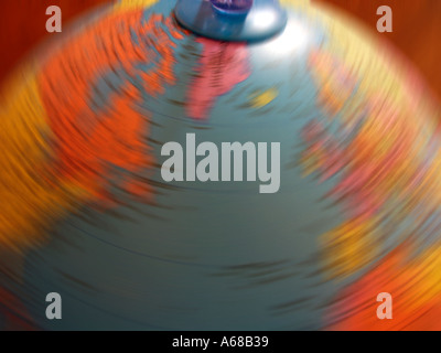 Childs toy globe spinning and blurred - Stock Image