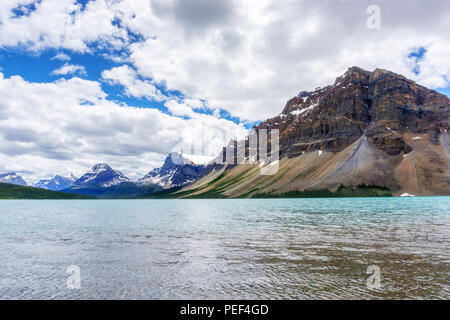 Bow Lake and Crowfoot Mountain in Banff National Park, with Crowfoot Glacier in the background. Located at the base of Bow Summit, the lake is fed by  - Stock Image