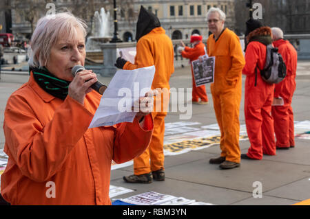 London, UK. 11th January 2019. A woman reads an account by former detainee Moazzam Begg of his detention and torture with UK comploicity as members of the Guantanamo Justice Campaign and London Guantanamo Campaign mark  the 17th anniversary of the first prisoners arriving at the illegal US camp.  The Trafalgar Square protest highlights the abuse, torture, lack of human rights, force-feeding and indefinite detention there and call for its closure. . Credit: Peter Marshall/Alamy Live News - Stock Image