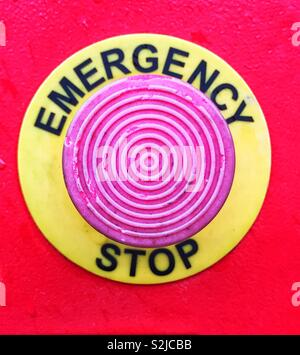 A big red Emergency Stop button in a square frame - Stock Image