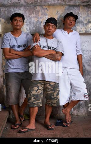 Three young Balinese brothers Ubud, Indonesia - Stock Image