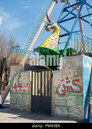 Shiraz, Iran - March 1, 2017 : Dragon figure on a ferris wheel at Azadi Amusement Park - Stock Image