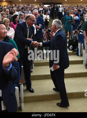 U.S. Secretary of State Rex Tillerson shakes hands with a State Department employee at the Department in Washington, - Stock Image