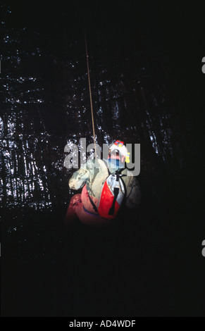 caver Richard Boud caving in Giants Cave Peak District National Park, Derbyshire - Stock Image