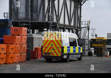 Newlyn, Cornwall, UK. 12th April 2019. Police have made a number of arrests under the modern slavery act at Cullompton after around 30 people were round in the back of a van. They were originally seen getting into the van at Newlyn earlier on this morning. There is still a police prescence at Newlyn harbour - pictured here. Credit: Simon Maycock/Alamy Live News - Stock Image