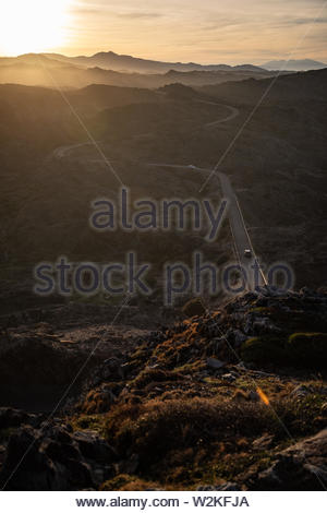 View of a mountain curved road with sunset sky in Cap de Creus, Catalunya - Stock Image