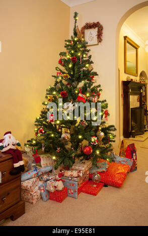 Christmas tree and presents at home - Stock Image