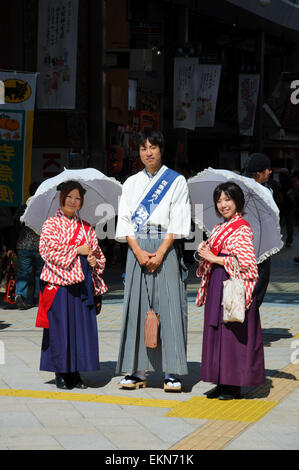 Young Japanese promotional people dressed in traditional costume, promoting the city of Matsuyama, Japan. Kimono, - Stock Image