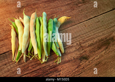 Healthy food. String beans, green and yelow raw asparagus. Close-up on a wooden table. Yardlong bean. Copy-space - Stock Image