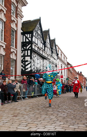 Andrew Mcanus winning the Mascots Pancake Race which is part of the traditional Shrovetide Fair in Bore Street Lichfield - Stock Image