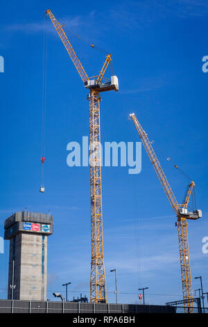 Construction tower cranes on the new Thames Quarter development by the railway at Reading, Berkshire which will be the tallest residential development - Stock Image
