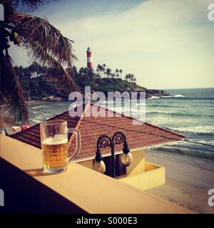 A beer overlooking the lighthouse beach, kovalum, Kerala, India - Stock Image