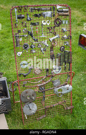 A display rack of classic vintage motorcycle spares for sale at the Banbury Run Autojumble, Oxfordshire, UK - Stock Image
