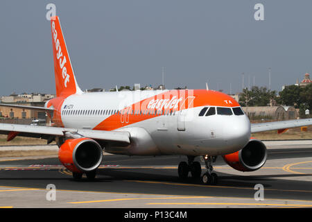 Airbus A320 commercial jet airplane belonging to the budget airline easyJet taxiing on arrival in Malta. Closeup view from the front. - Stock Image