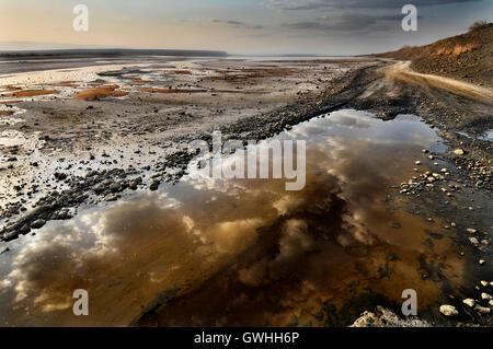 Reflections of the sky in Lake Magadi, Kenya. - Stock Image