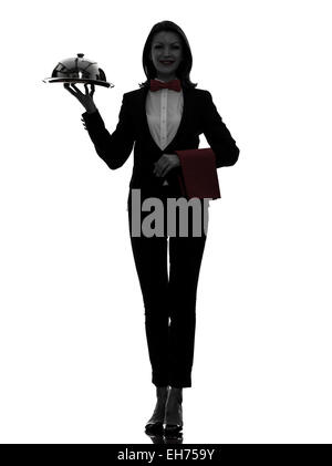 one  woman waiter butler serving dinner with catering dome in silhouette on white background - Stock Image