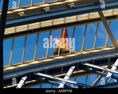 Worker on the roof of St Pancras Station London - Stock Image