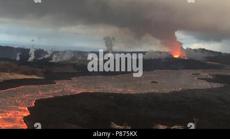 Lava flows from multiple channels toward the ocean after the north side of the Kilauea volcano crater collapsed July 7, 2018 in Hawaii. The recent eruption continues destroying homes, forcing evacuations and spewing lava and poison gas on the Big Island of Hawaii. - Stock Image