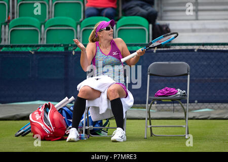 Professional tennis player Anastasia Rodionova arguing with the umpire from her chair during a match. - Stock Image