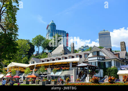 The entrance front of the Queen Victoria Place Restaurant on Niagara Parkway, Niagara Falls, Ontario, Canada on a sunny day. Casino in background. - Stock Image